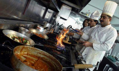 Pakistani cooks prepare dishes in the ki